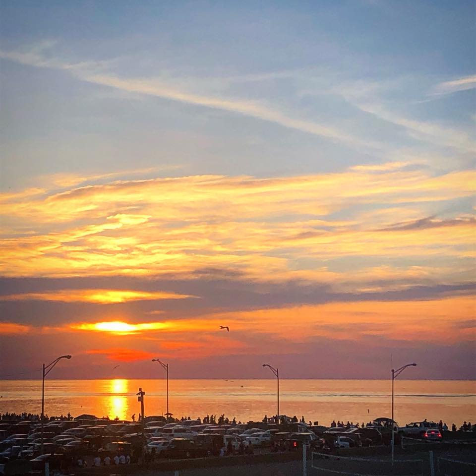 Sun setting over Lake Michigan from rooftop patio